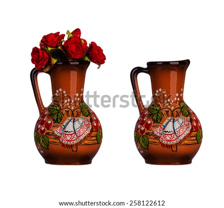 Ceramic vase with artificial flowers - stock photo