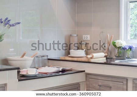 Ceramic ware and kitchen ware setting up on the counter in the kitchen - stock photo