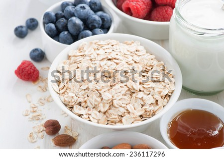 cereal and various delicious ingredients for breakfast, close-up, horizontal - stock photo