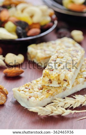 Cereal bars of granola with nuts and raisins on the table - stock photo