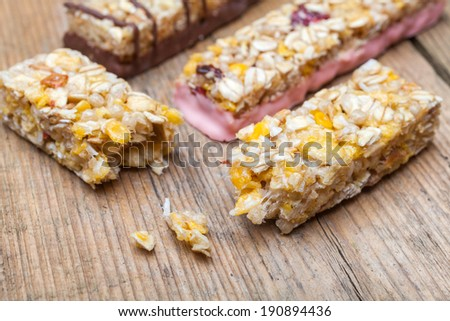 Cereal bars on a wooden table - stock photo