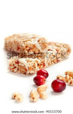 Cereal bars with puffed wheat and cranberries, closeup shot, focus on wheat flakes - stock photo