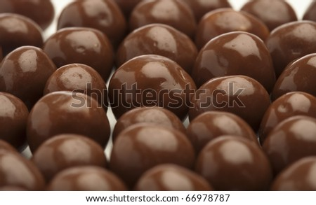 cereal chocolate balls on a white background - stock photo