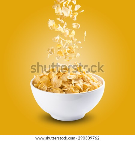 Cereal Corn Flakes Falling Into A Bowl - stock photo