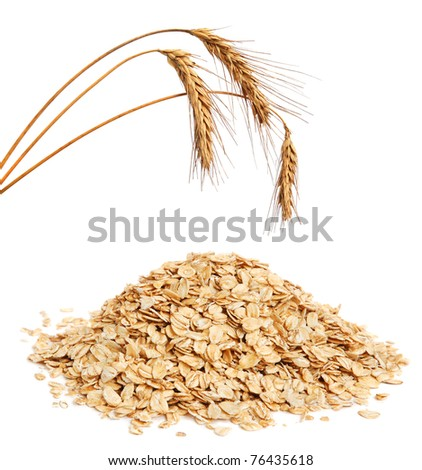 Cereal flakes and wheat ears on white background - stock photo