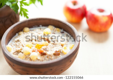 Cereal flakes with hot milk - a quick breakfast, close-up - stock photo