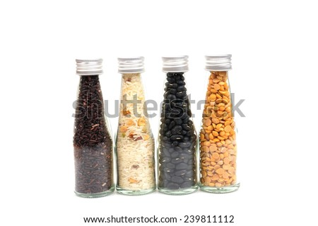 Cereal in bottle Isolated on white  - stock photo