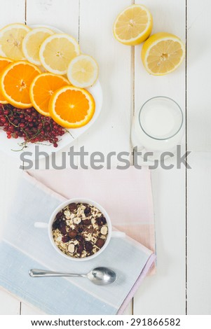 Cereal on white wooden table. - stock photo