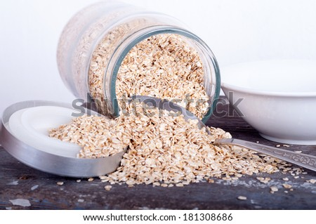 cereal spilling out from a jar - stock photo