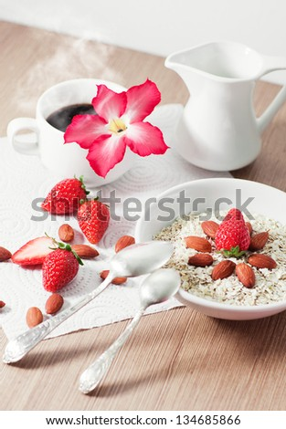 cereal with fresh strawberry with hot coffee