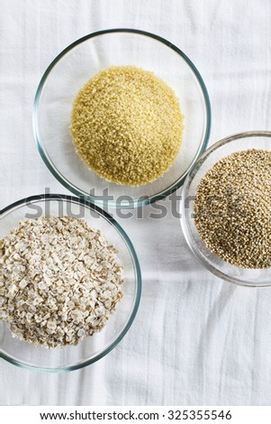 Cereals in bowls : Oats, Couscous, Quinoa - stock photo