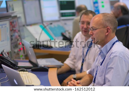 CERN, GENEVA - 20 NOV 2011 - Physicist at the control desk of the ATLAS experiment, at the days of re-opening of LHC, the Large Hadron Collider international high-energy physics experiment. - stock photo