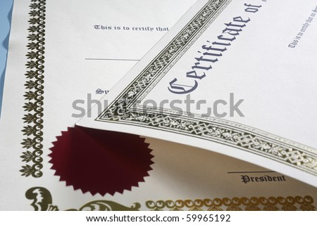 Certificate on the blue table. - stock photo