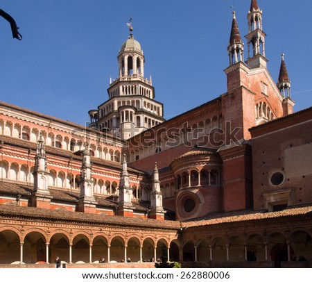 Certosa di Pavia, Italy - March 8, 2015: Cloister with views of the church's domes and spiers. Especially the red brick used for construction and the light color marble.