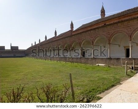 Certosa di Pavia, Italy - March 8, 2015: Large garden surrounded by the ancient dwellings of the monks. Each house separated from the others to keep the enclosure.