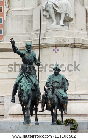 Cervantes monument placed on Plaza de Espana in Madrid, Spain. In front of monument are sculptures of Don Quijote and Sancho Panza - stock photo