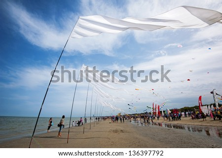 CERVIA, ITALY - APRIL 25: Sky full of kites for International Kite Festival on April 25, 2013 in Cervia. This Festival brings together kite flyers from all over the world every year since 1981. - stock photo