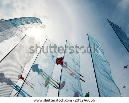 CERVIA, ITALY - APRIL 26, 2015: Sky full of kites for International Kite Festival. This Festival brings together kite flyers from all over the world every year since 1981. - stock photo
