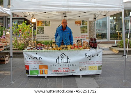 CERVIA, ITALY-MARCH 27, 2016: biological honey stand at the village Sunday market. This market is very popular and attract thousands of tourists.