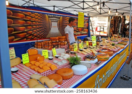 CERVIA, ITALY-SEPTEMBER 21, 2014: cheese  stand at the annual International food outdoor market. This market is very popular and attract thousands of tourists. - stock photo