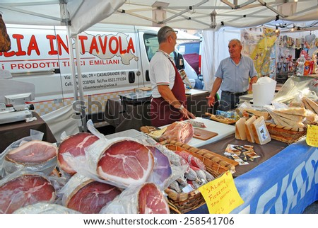 CERVIA, ITALY-SEPTEMBER 21, 2014: Emilia ham and cheese  stand at the annual International food outdoor market. This market is very popular and attract thousands of tourists. - stock photo