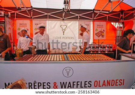 CERVIA, ITALY-SEPTEMBER 21, 2014: Nederland crepes and waffles  stand at the annual International food outdoor market. This market is very popular and attract thousands of tourists. - stock photo