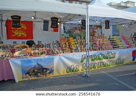 CERVIA, ITALY-SEPTEMBER 21, 2014: Normandie food  stand at the annual International food outdoor market. This market is very popular and attract thousands of tourists. - stock photo