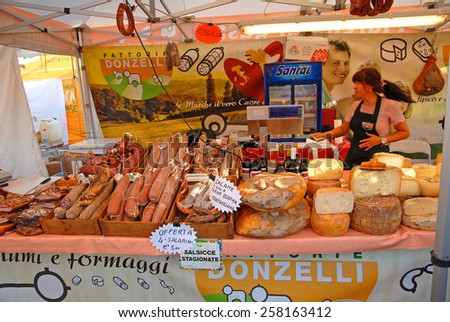 CERVIA, ITALY-SEPTEMBER 21, 2014: salami and cheese stand at the annual International food outdoor market. This market is very popular and attract thousands of tourists. - stock photo