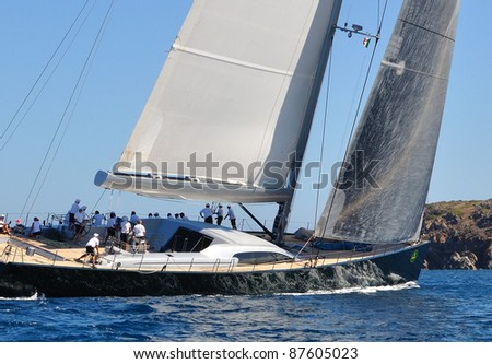 CERVO, ITALY - SEPTEMBER 10: The DSK Sailing team compete in the Maxi Yacht Rolex Cup boat race on September 10, 2011 in Porto Cervo, Italy. - stock photo