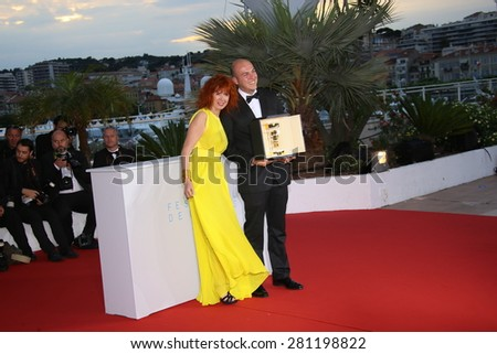 Cesar Augusto Acevedo, Sabine Azema  attend a photocall for the winners of the Palm D'Or during the 68th annual Cannes Film Festival on May 24, 2015 in Cannes, France. - stock photo