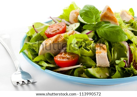 Cesar salad with roasted chicken meat - stock photo