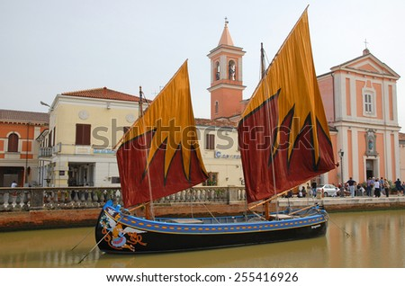 CESENATICO, ITALY- SEPTEMBER 21, 2014: antique fishing sailing boats at the harbor. The harbor designed by Leonardo da Vinci attracts thousands of tourists every month. - stock photo