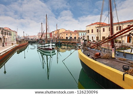 Cesenatico, seaside town in Italy, where historic fishing sailing boats of the Adriatic sea are displayed in the canal - stock photo