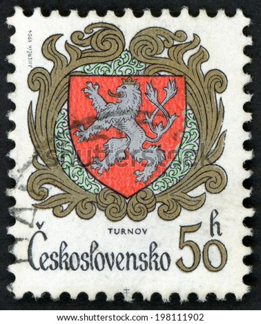 CESKOSLOVENSKO - CIRCA 1984: post stamp printed in Czechoslovakia (Czech) shows Arms of Turnov; lion with 2 tails, arms of various cities; Scott 2500 A847 50h red brown gray, circa 1984