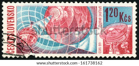 CESKOSLOVENSKO - CIRCA 1966: stamp printed in Czechoslovakia shows telstar over earth & receiving station; US and Russian achievements in space research; Scott 1427 A540 1.20k red blue, circa 1966 - stock photo