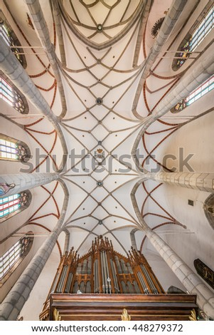 CESKY KRUMLOV, CZECH REPUBLIC - JUNE 30, 2016: Interior of St. Vitus' Church, a Roman Catholic Church that after the castle is the second landmark of the town (1400 ca.), close-up of the ceiling.