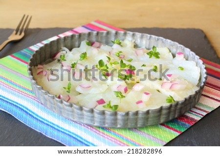 Ceviche, seafood dish popular in Central and South America made out of raw fresh fish cured in citrus juices, chopped red onions and spiced with herbs and chili peppers - stock photo