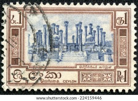 CEYLON - CIRCA 1960: A stamp printed in Ceylon (present time Sri Lanka) shows architectural ruins, circa 1960 - stock photo
