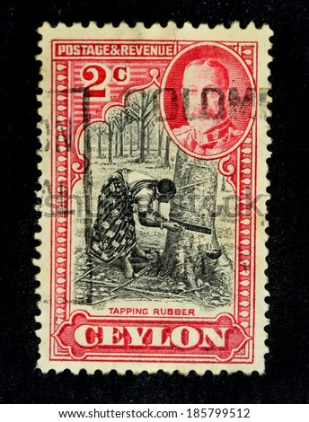 CEYLON-CIRCA 1935: An old ceylon postal stamp shows image of  tapping rubber, circa 1935