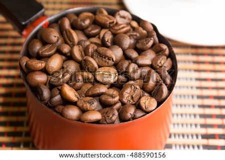 Cezve with coffee beans