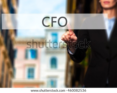 CFO (Chief Financial Officer) - Isolated female hand touching or pointing to button. Business and future technology concept. Stock Photo