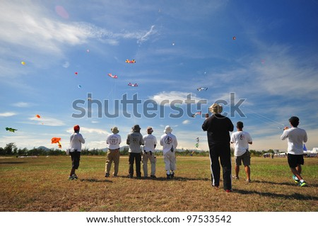CHA-AM - MARCH 9: Participants are playing kites in the 12th Thailand International Kite Festival on March 9, 2012 in Naresuan Camp, Cha-am, Thailand.