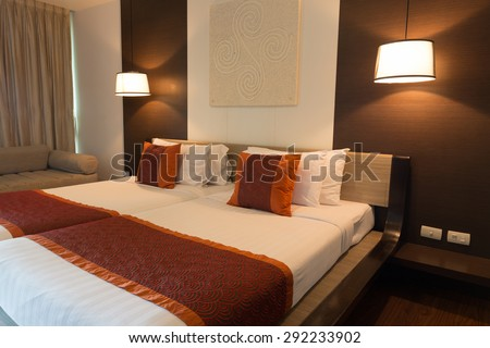 CHA-AM, THAILAND - JUNE 18: Double bed hotel room with lamps turn on in Spring Field at Sea hotel in Cha-am, Thailand during 19 June, 2015 - stock photo
