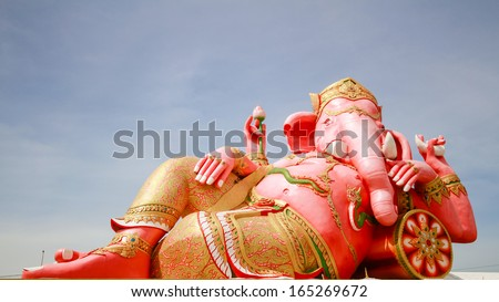 CHACHOENGSAO, THAILAND - NOV 16:  Sculpture of a giant Reclining Ganesha on Nov 16, 2013. This is the biggest Ganesha in Thailand . Ganesha is a Hindu deity and has an elephant head and four arms.