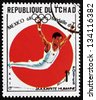 CHAD - CIRCA 1969: a stamp printed in Chad shows Sawao Kato, All Around Gymnastics, Winner of 1968 Olympic Games, Mexico, circa 1969 - stock photo
