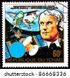 CHAD - CIRCA 1983: A stamp printed in Chad shows Wernher von Braun, creator of the German V2 and the American Apollo V rockets, and the Space Shuttle repairing a satellite, circa 1983. - stock photo