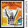 CHAD - CIRCA 1969: a stamp printed in Chad shows Willie Davenport, 110m Hurdles, Running, Winner of 1968 Olympic Games, Mexico, circa 1969 - stock photo