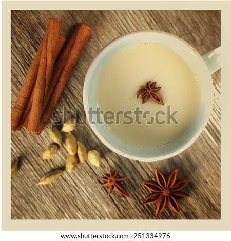 Chai tea with cinnamon, anise and cardamom.  Instagram style picture.  Cross processed to look like and instant picture. - stock photo