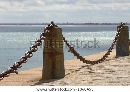 chain barrier on a pier - stock photo