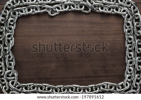 chain frame on the brown wooden background